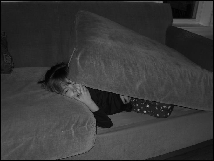 Girl under cushions BW Darker